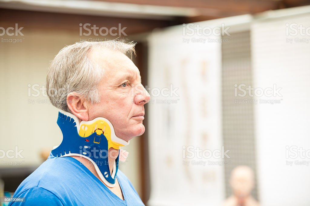 Mature patient wearing a spine collar stock photo
