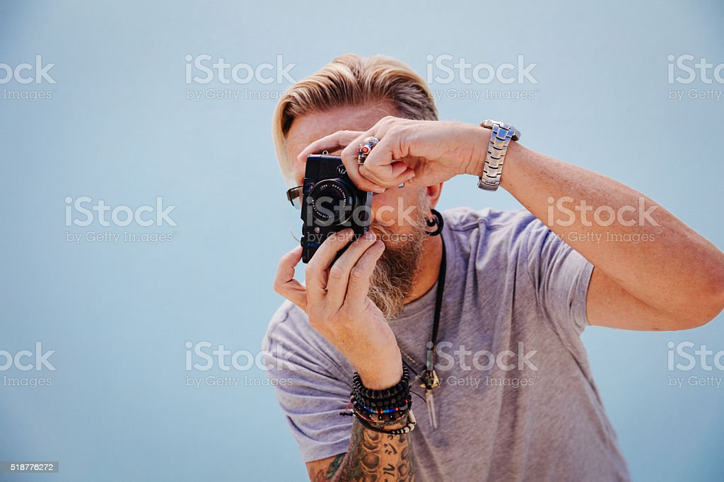 Mature photographer with scary skull ring stock photo