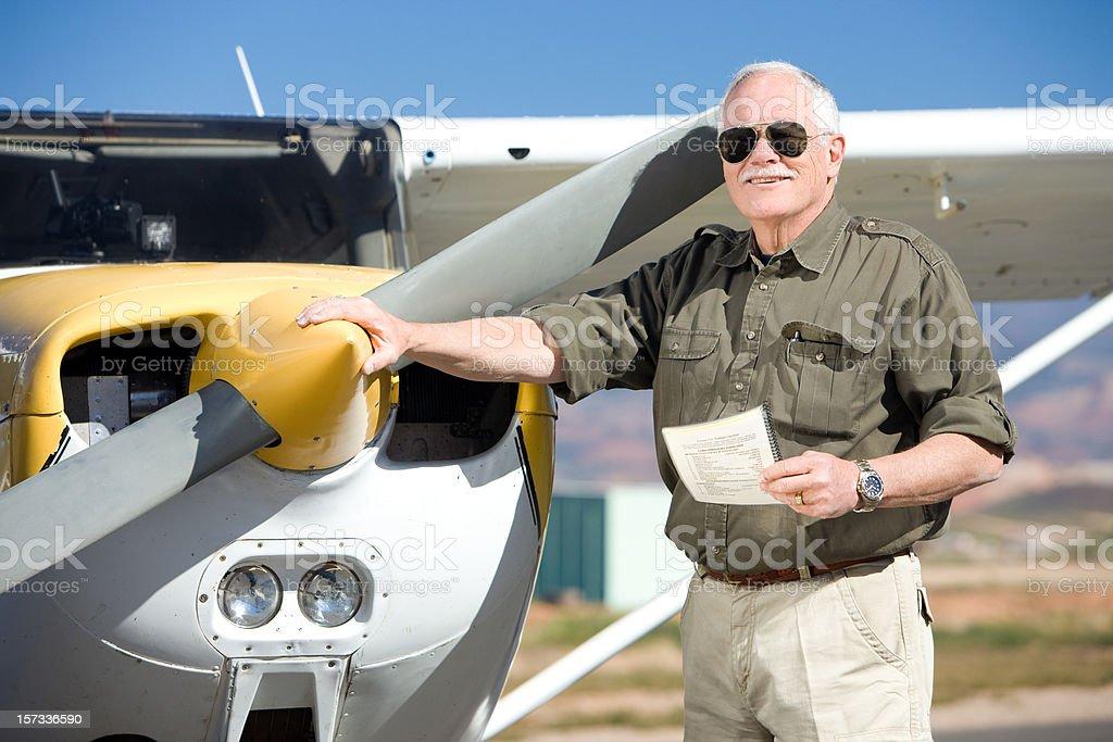 Mature Pilot Doing Pre-Flight Inspection stock photo
