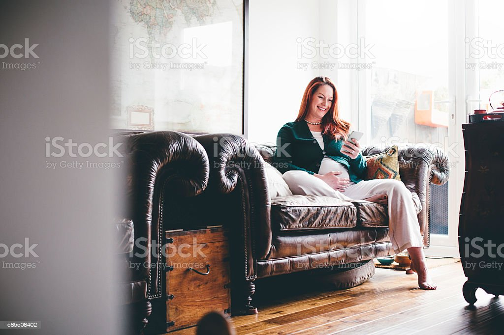 Mature Pregnant Woman Using Smartphone stock photo