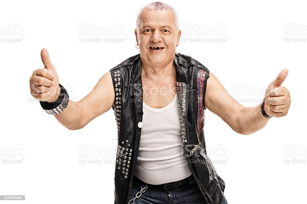 Mature punk giving thumbs up stock photo