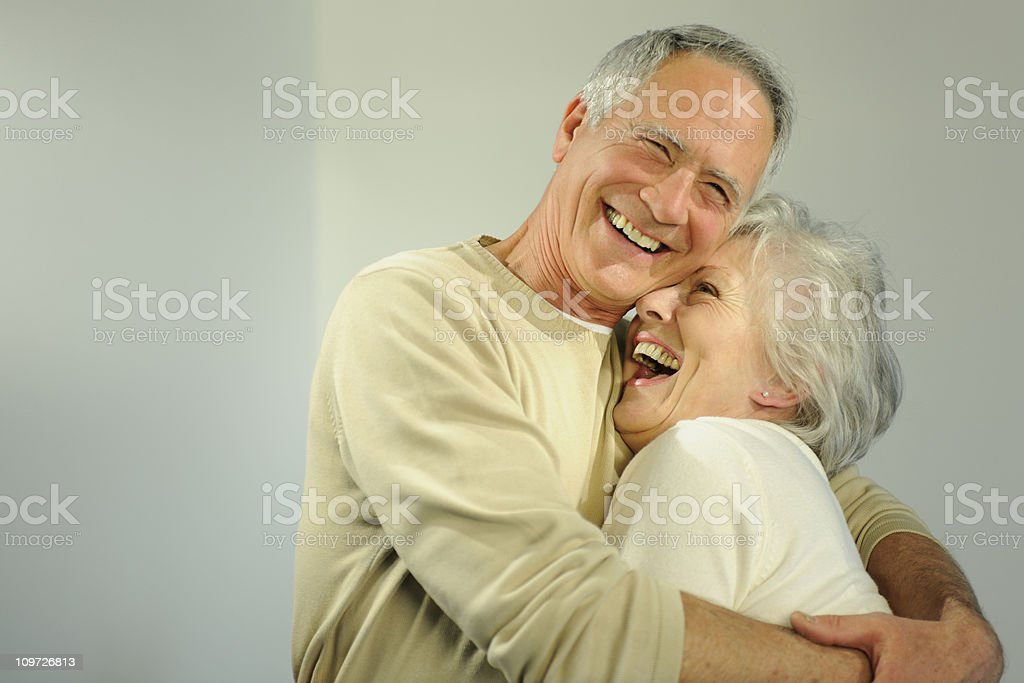 Mature senior couple hugging. stock photo