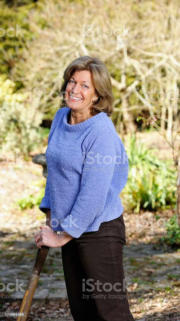 Mature/ Senior Woman Preparing A Patch In The Garden stock photo