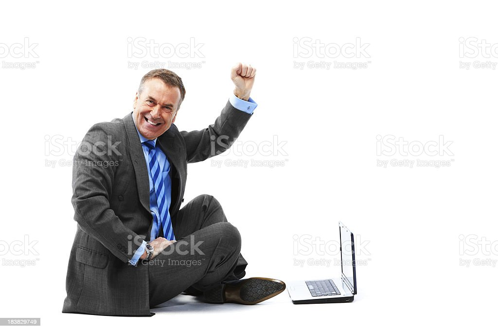 Mature sitting man isolated on white background with laptop royalty-free stock photo
