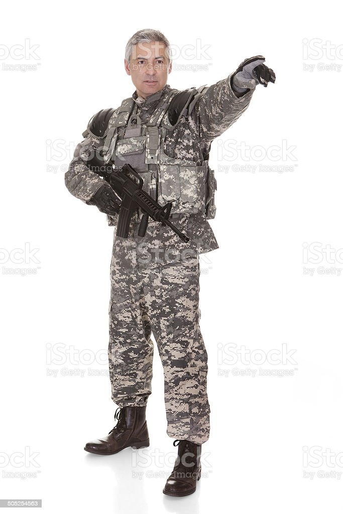 Mature Soldier Holding Rifle royalty-free stock photo