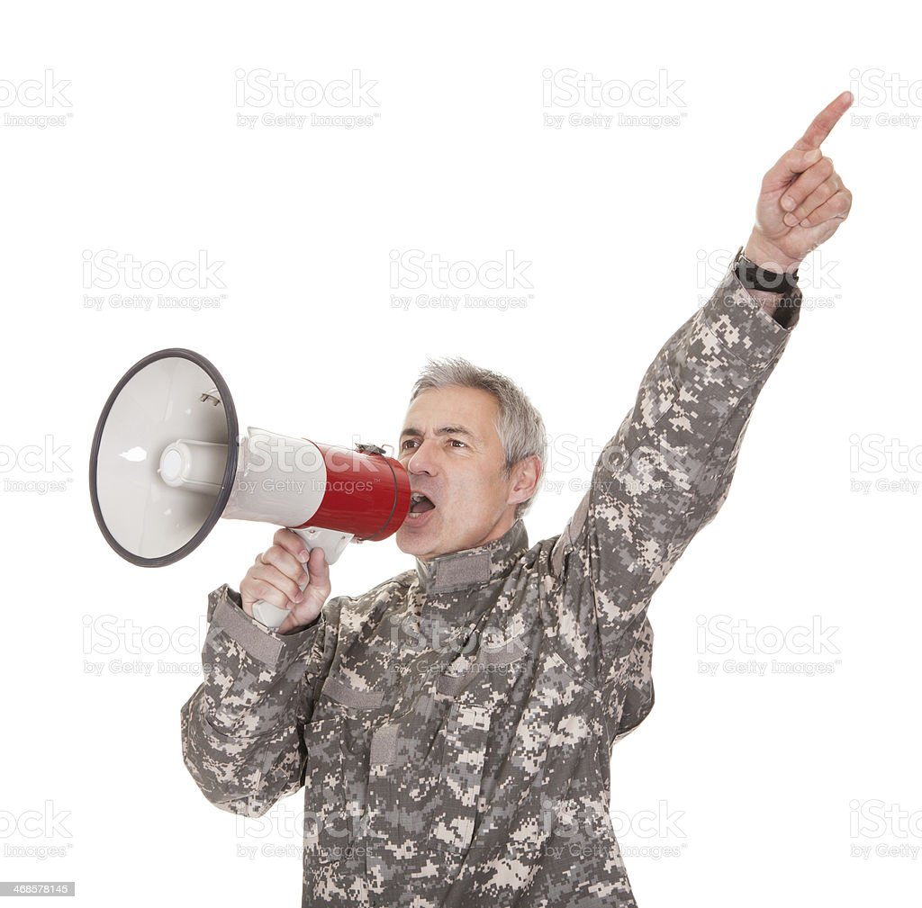 Mature Soldier Shouting Through Megaphone stock photo