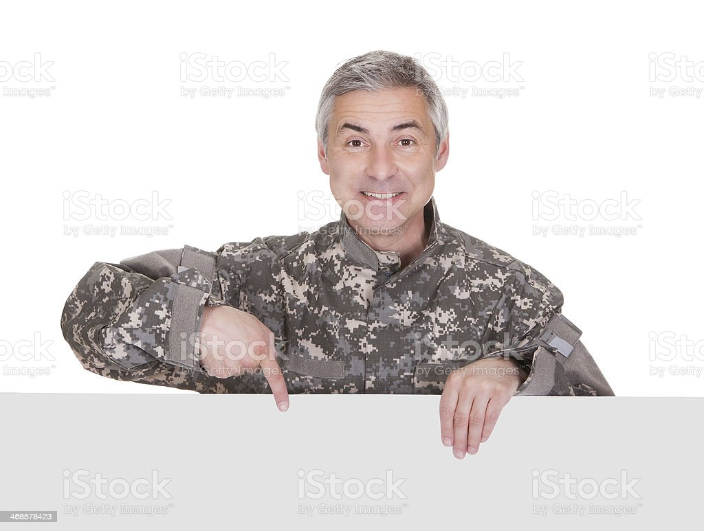 Mature Soldier Showing On Blank Placard royalty-free stock photo
