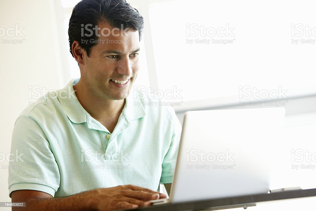 Mature student using computer in class royalty-free stock photo