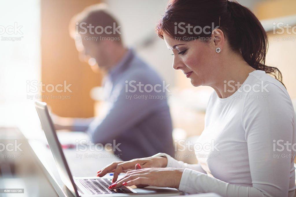 Mature student using laptop stock photo