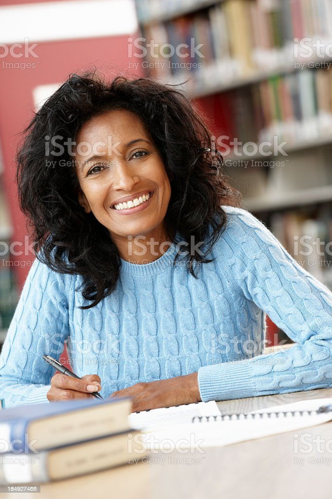 Mature student working in library royalty-free stock photo