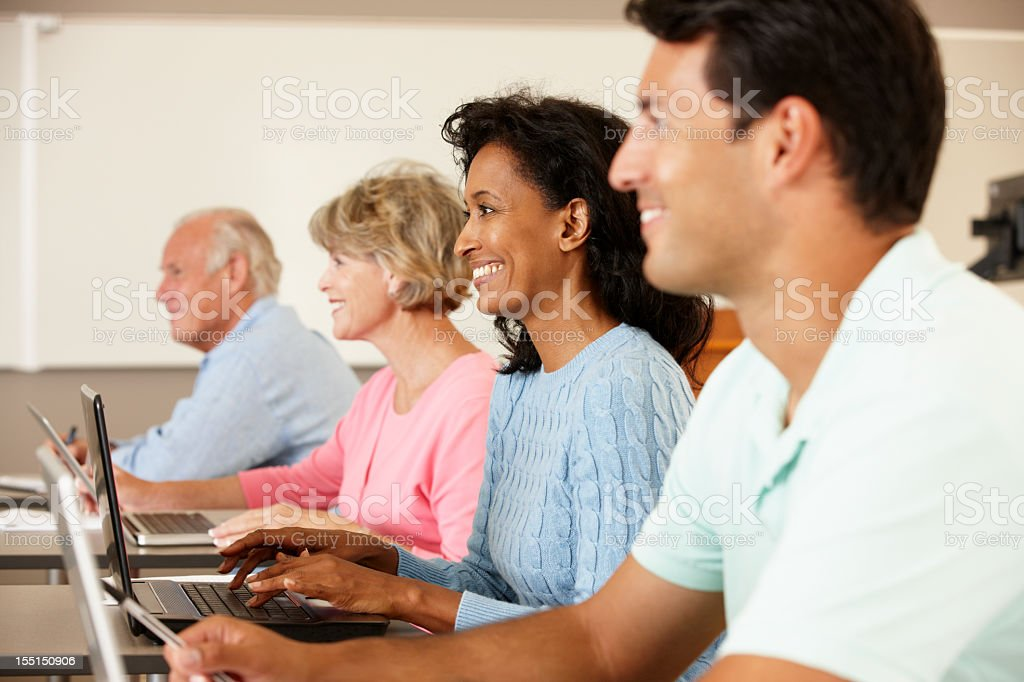 Mature students in class royalty-free stock photo