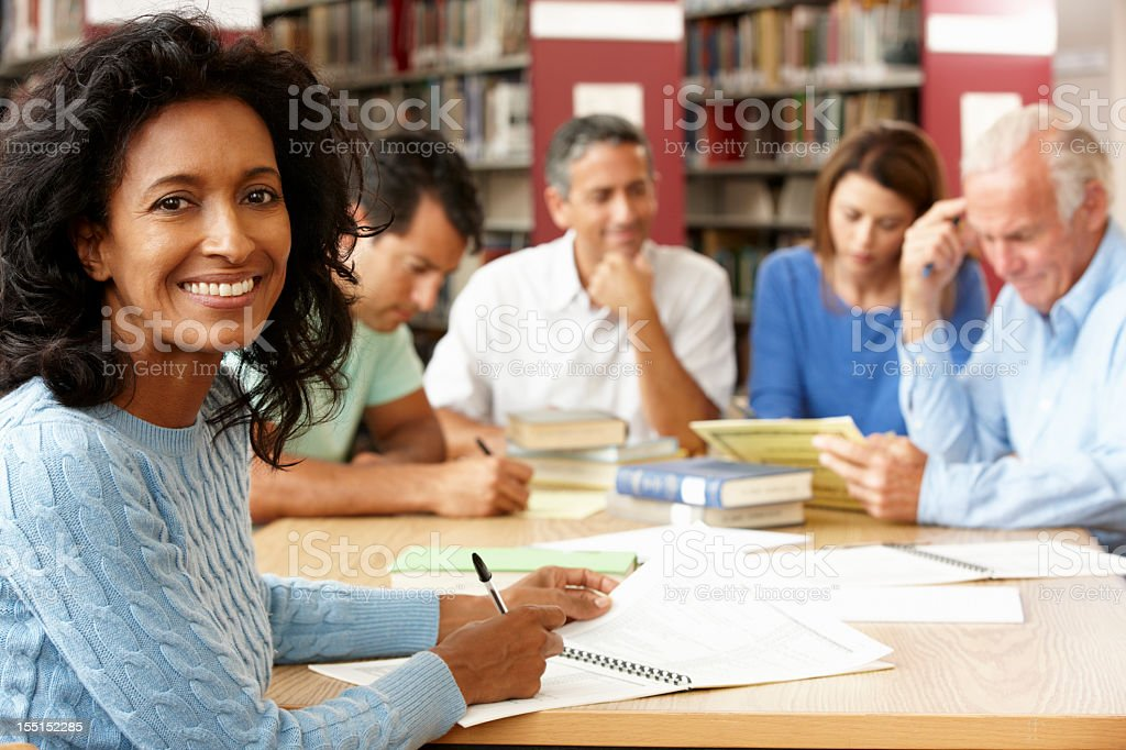 Mature students working in library royalty-free stock photo