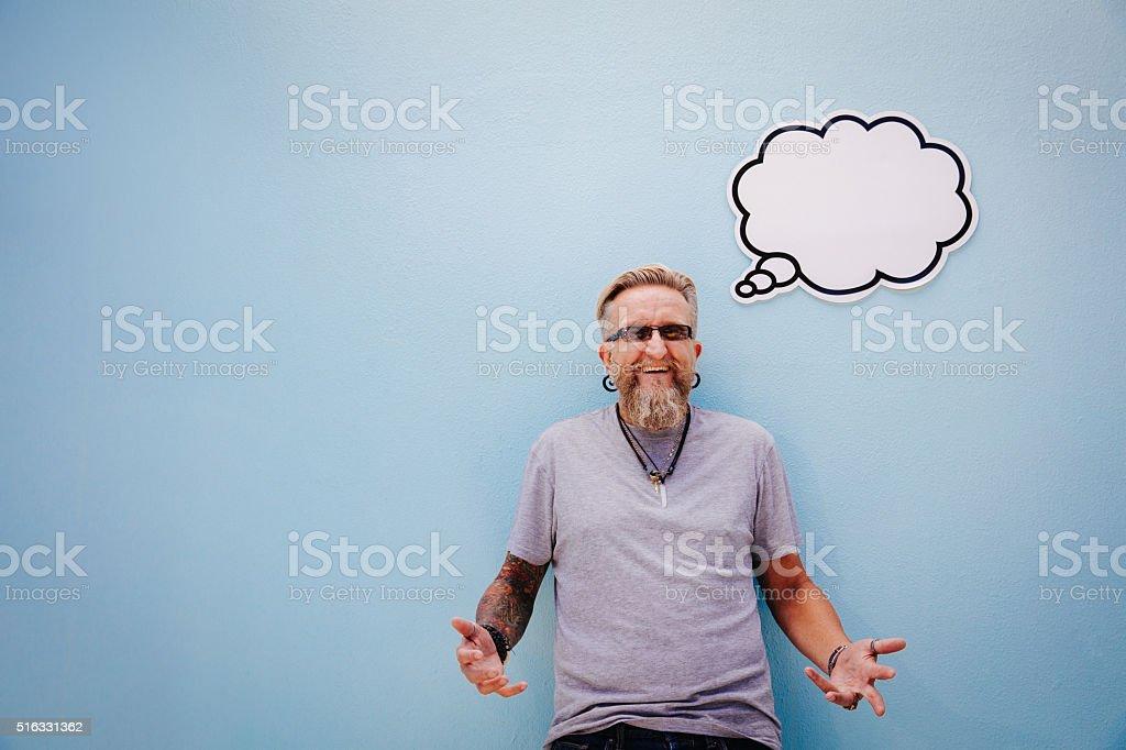 Mature tattooed thinking man stock photo