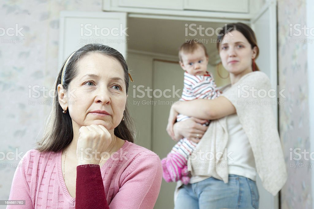 Mature thoughtful woman against her adult  daughter royalty-free stock photo