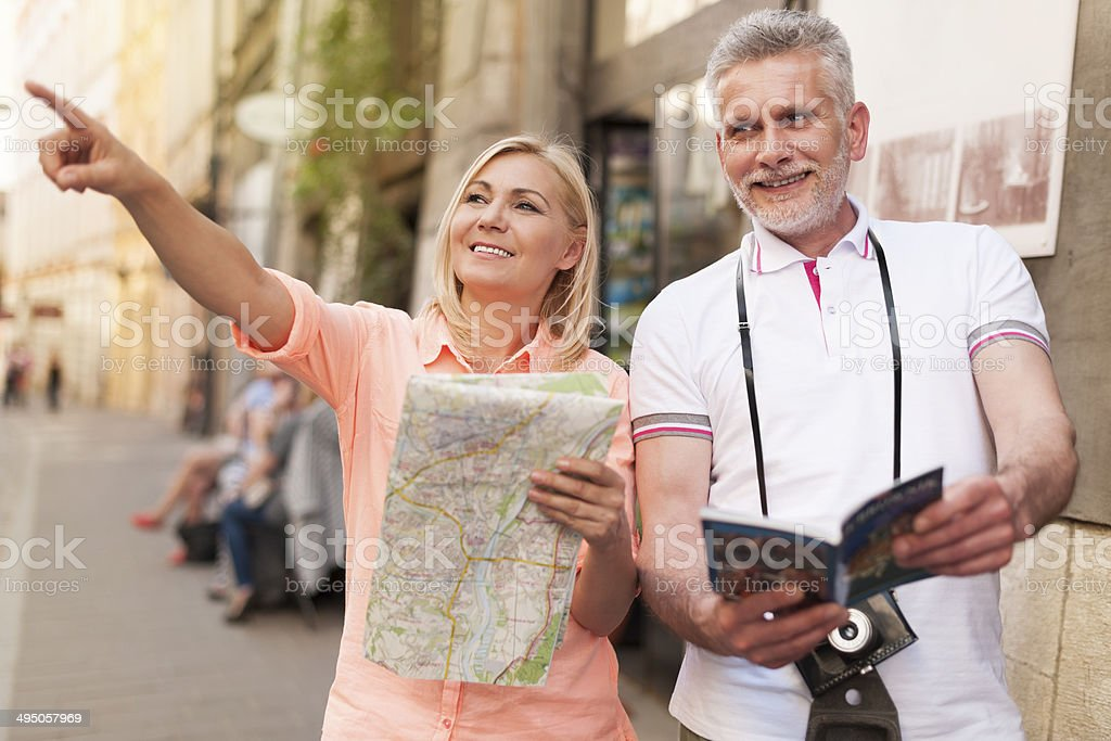 Mature tourist sightseeing city with map and guidebook stock photo