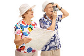 Mature tourists with a generic map and a camera
