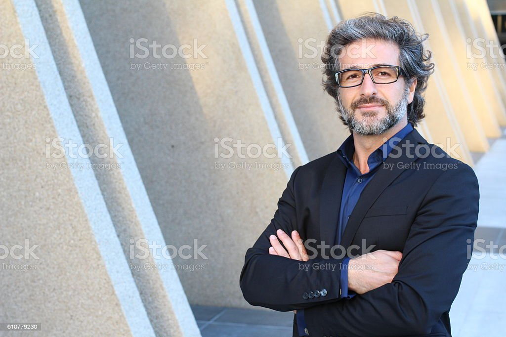 Mature urban business man with specs stock photo