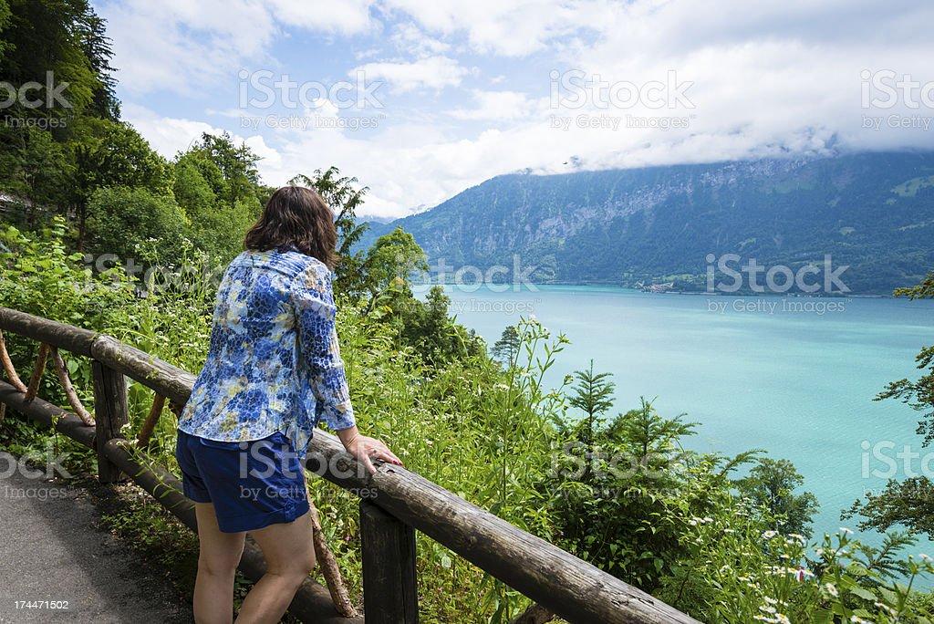 Mature woman admiring the beauty of Lake Thun, Switzerland stock photo