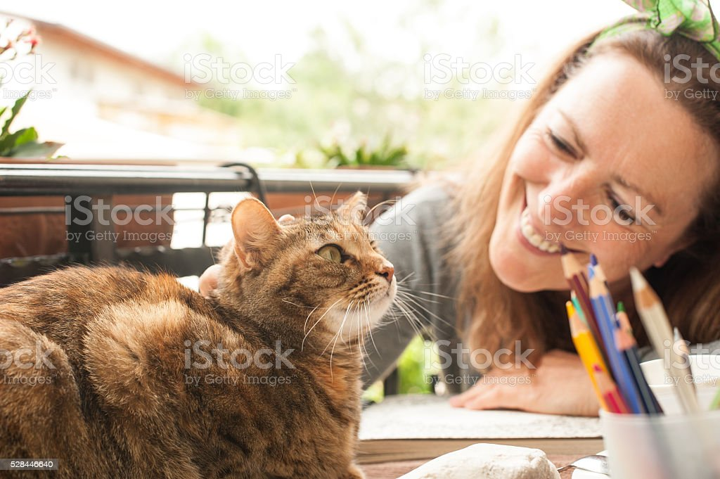 Mature woman and cat, Coloring stock photo