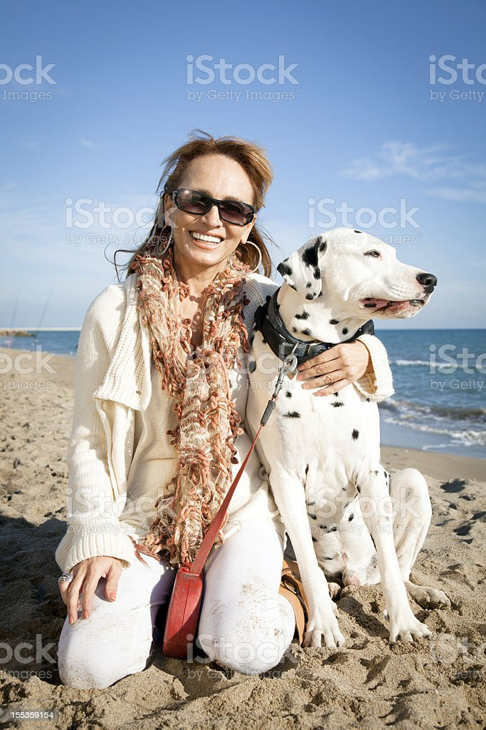 Mature woman and dalmatian dog stock photo