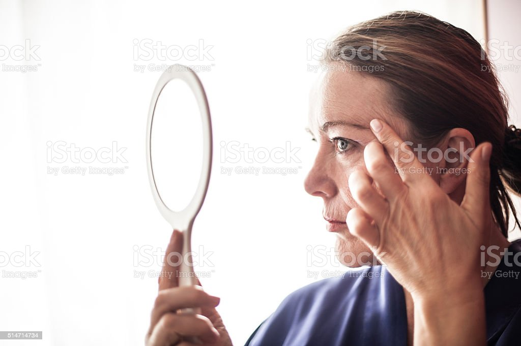 Mature woman and face care stock photo