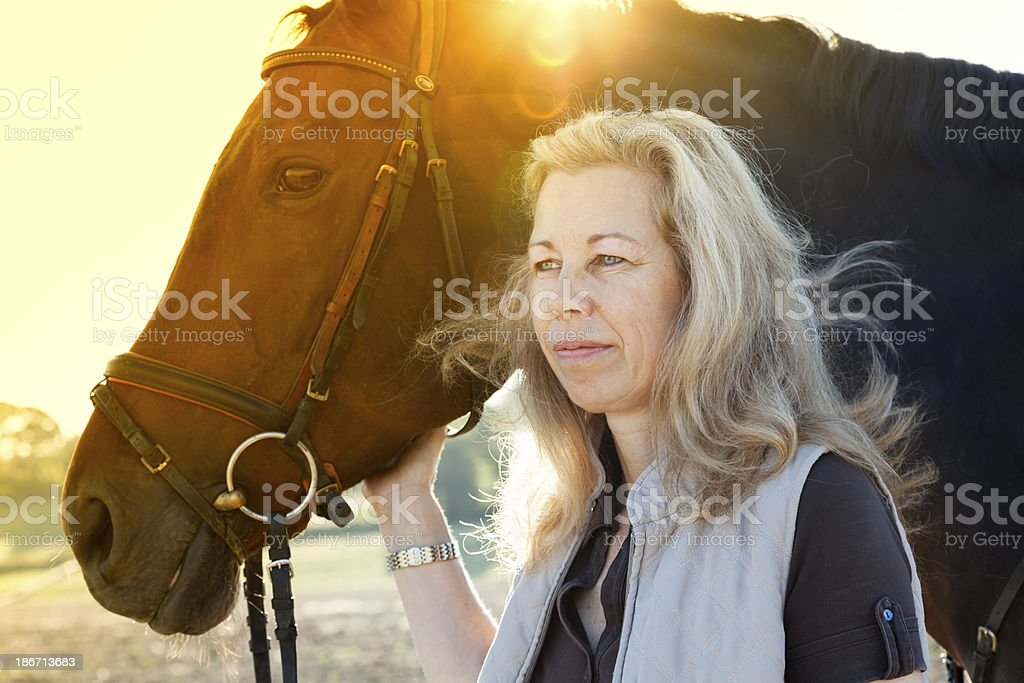 mature woman and her horse friendship royalty-free stock photo