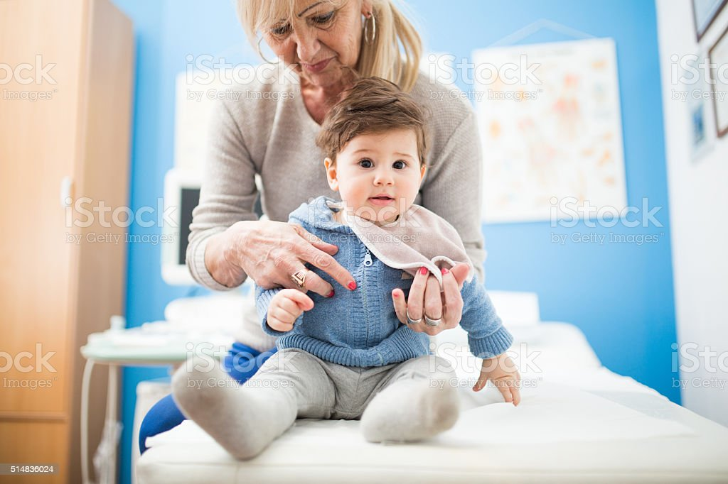 Mature woman and her son at the doctor stock photo
