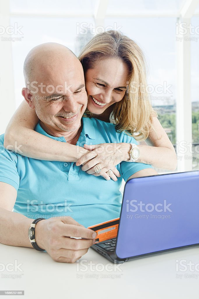 Mature woman and man buying thhrough the internet royalty-free stock photo