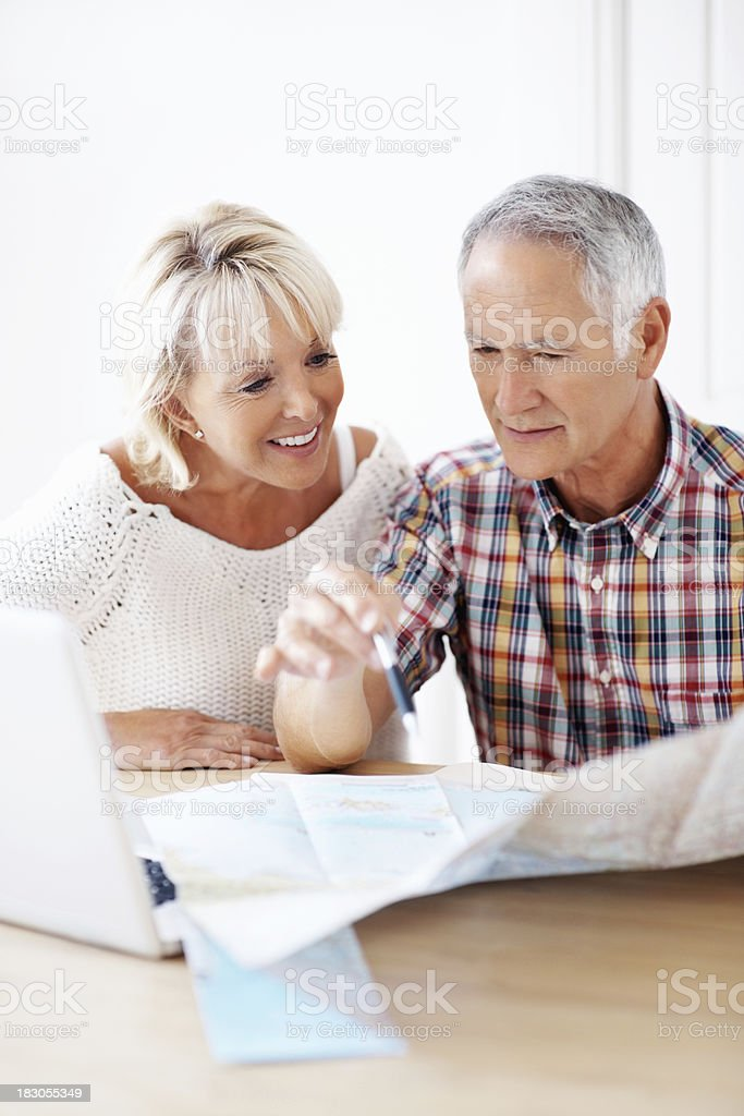 Mature woman and man planning vacation with map royalty-free stock photo