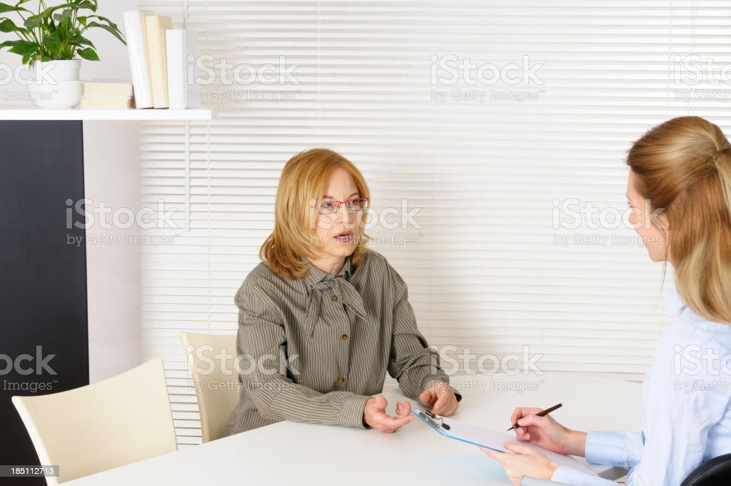 Mature Woman and Psychiatrist royalty-free stock photo