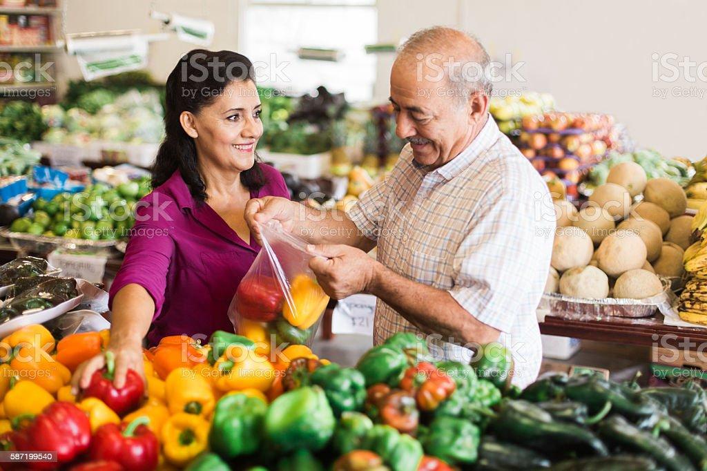 Mature woman and senior man shopping at supermarket stock photo