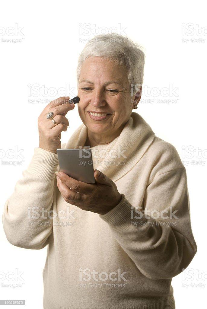 Mature woman applying blusher royalty-free stock photo