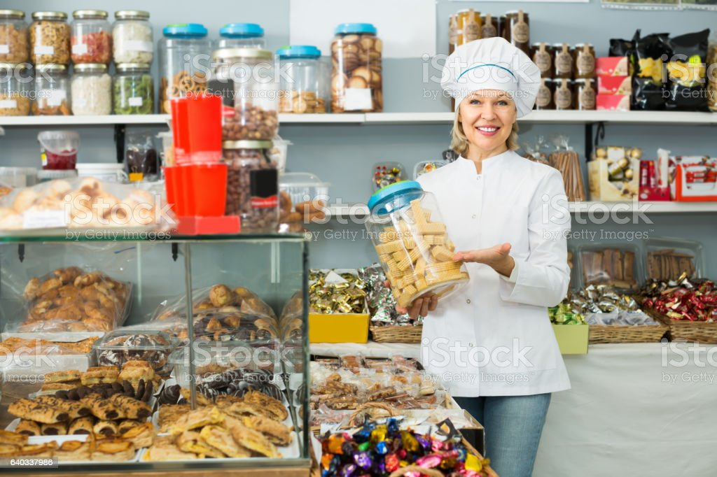 Mature woman at confectionery stock photo