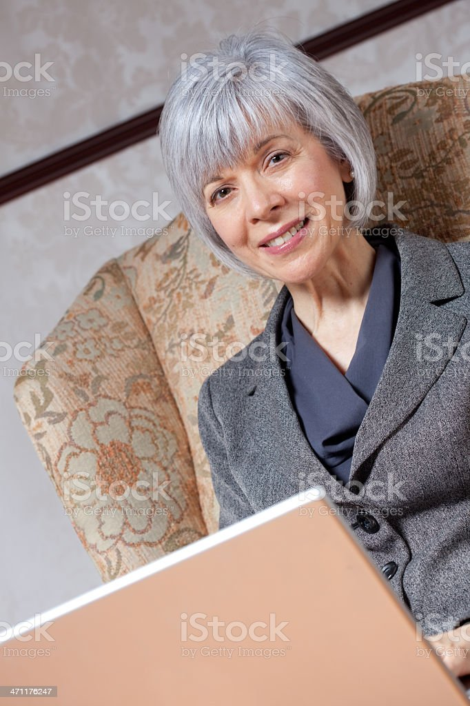 Mature Woman at home with laptop royalty-free stock photo