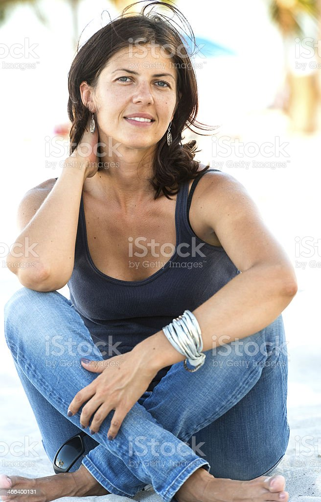 Mature woman at the beach stock photo