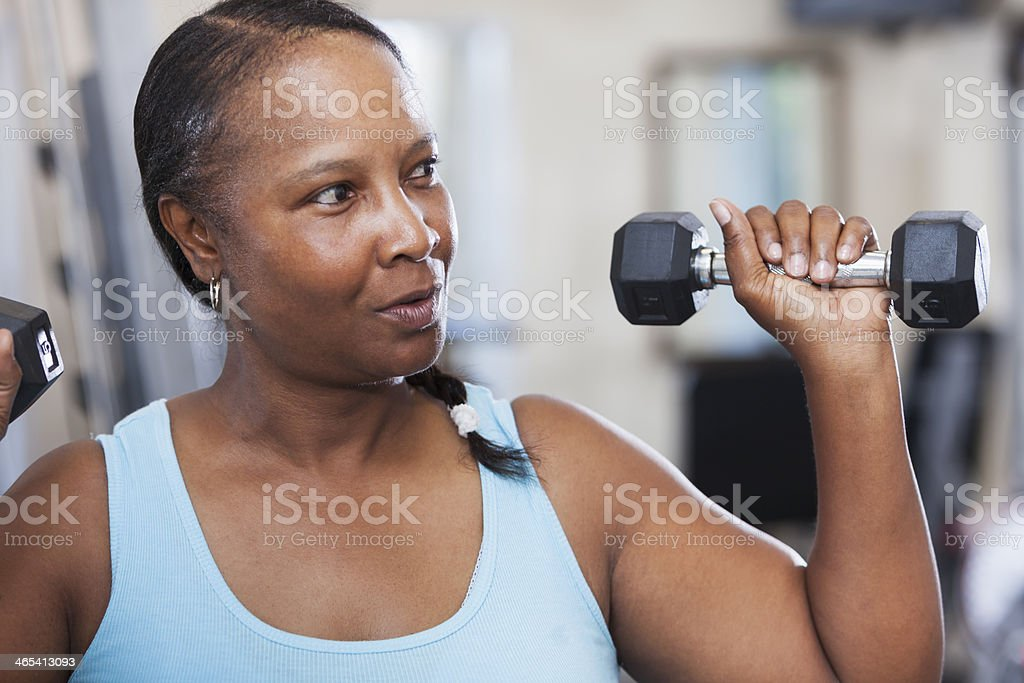 Mature woman at the gym stock photo