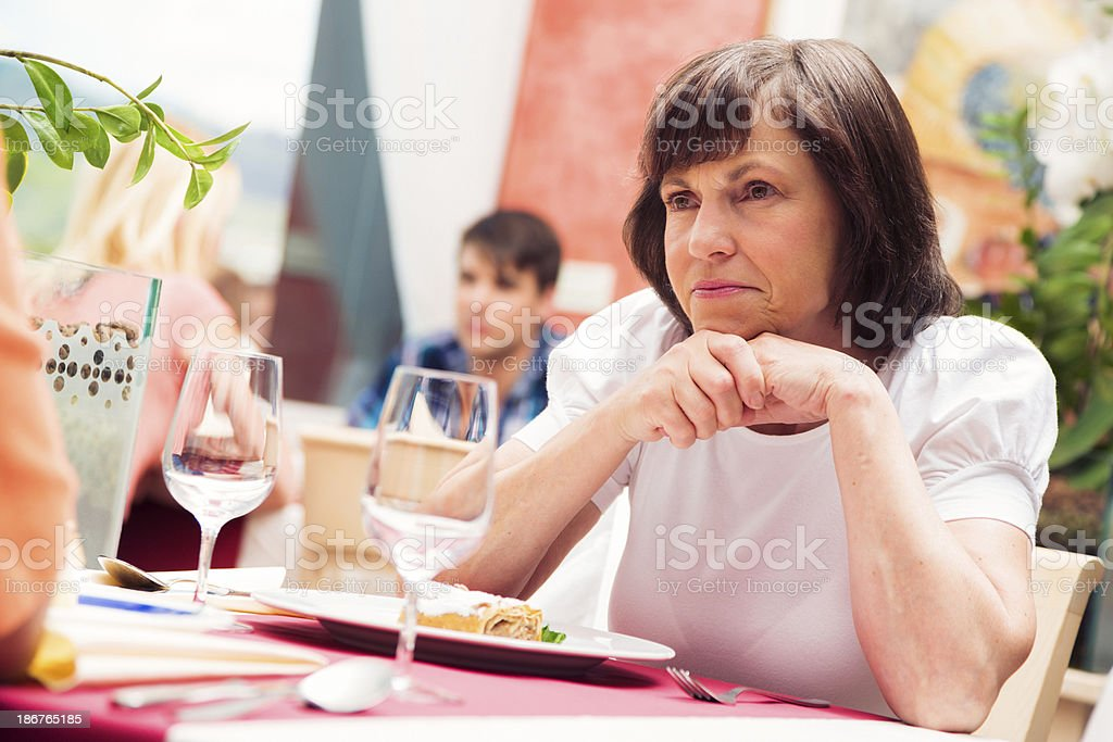 mature woman at the restaurant royalty-free stock photo