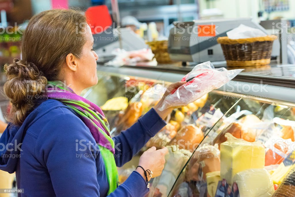 Mature woman at the supermarket stock photo
