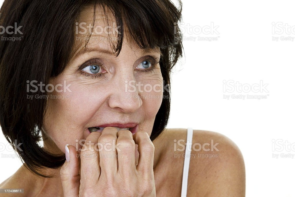 Mature woman biting her nails royalty-free stock photo