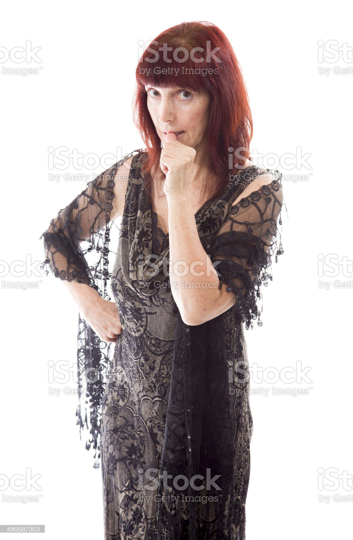 Mature woman biting nail royalty-free stock photo