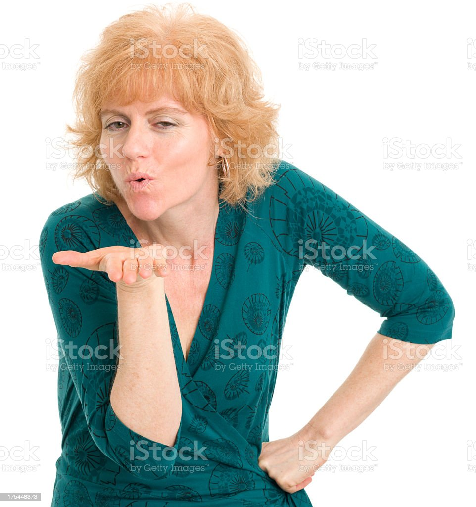 Mature Woman Blows A Kiss stock photo