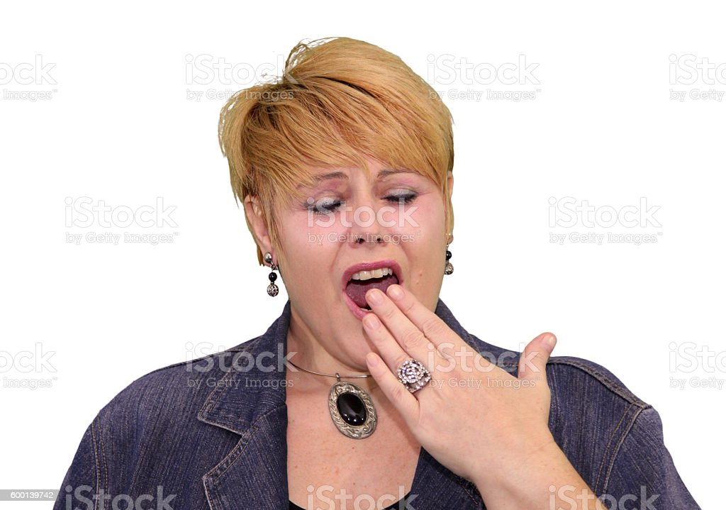 Mature Woman Body Language - Bored Yawning stock photo
