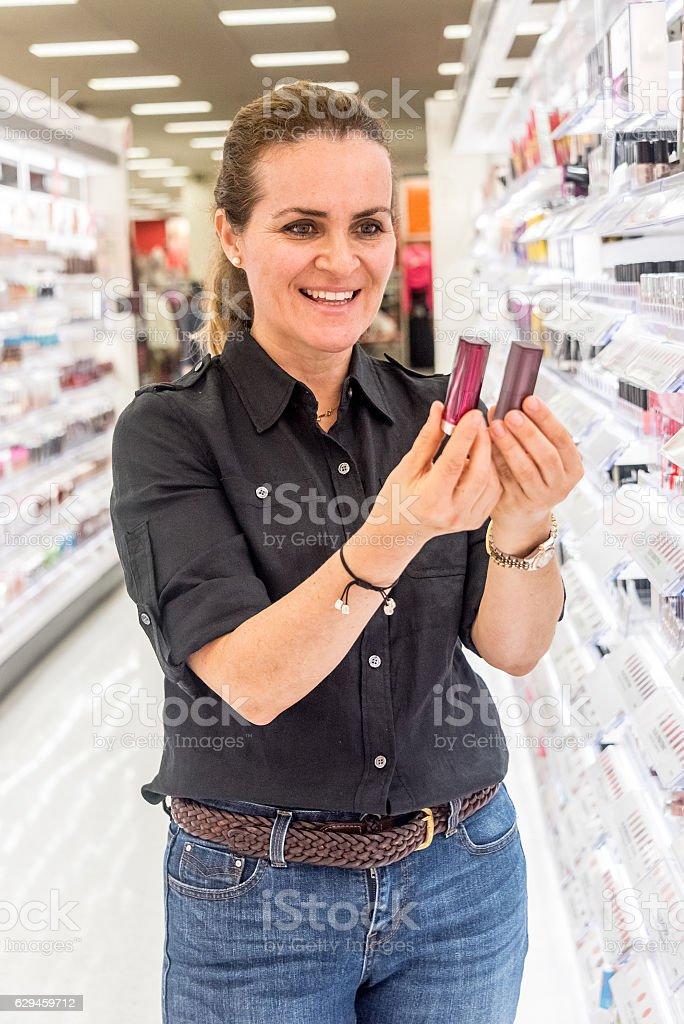 Mature woman buying cosmetics stock photo