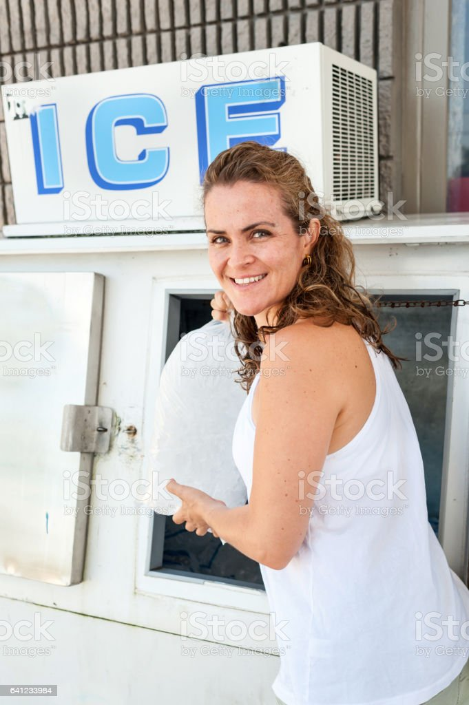 Mature woman buying ice stock photo
