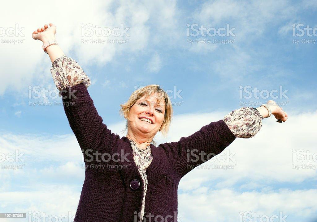 Mature woman celebrating royalty-free stock photo