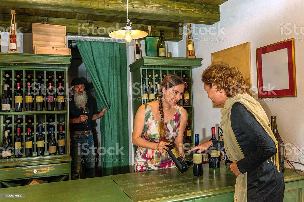 Mature Woman Choosing Wine, Cellar in Brda,Slovenia, Europe stock photo