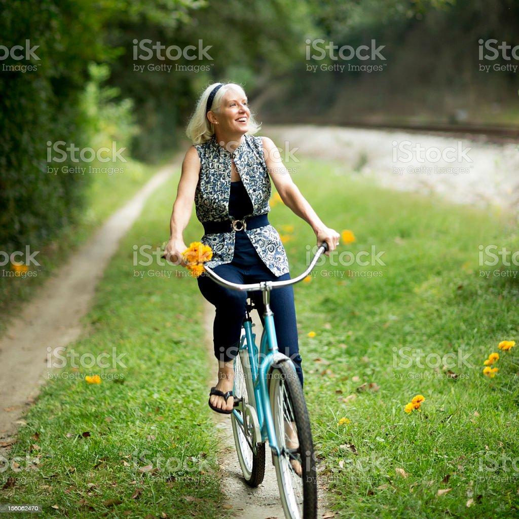 Mature Woman Cycling At Park. royalty-free stock photo