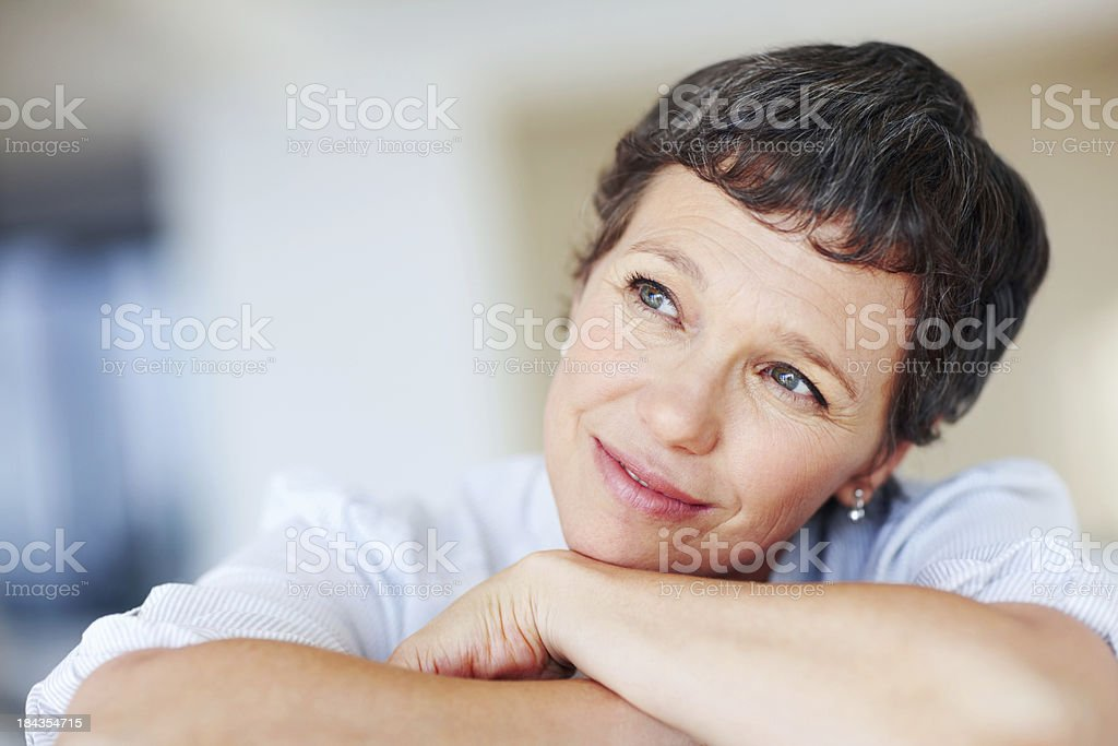 Mature woman daydreaming royalty-free stock photo