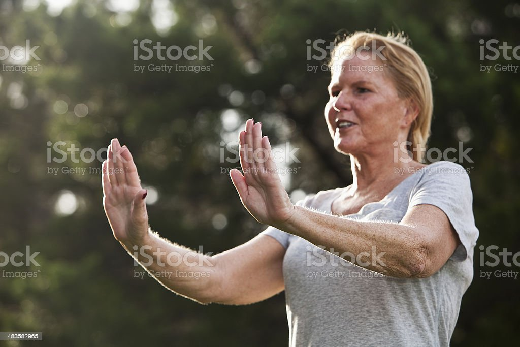Mature woman doing relaxation exercises stock photo