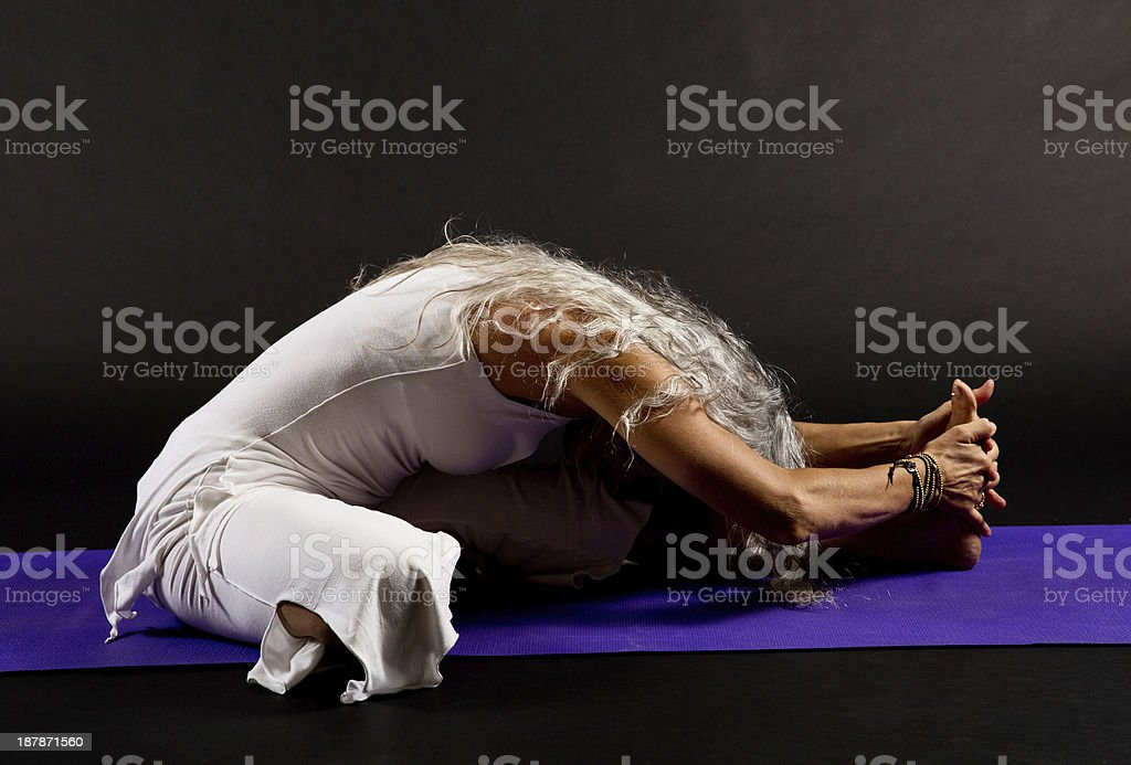 mature woman doing yoga stock photo